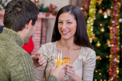 Couple holding glasses with champagne and celebrate Christmas ni. Romantic couple celebrate Christmas night stock photo