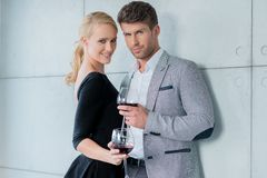 Couple Holding Glasses of Red Wine Royalty Free Stock Photo