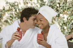 Couple Holding Glasses Of Strawberry Juice Stock Photography