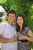 Couple holding glasses of white wine Royalty Free Stock Photos