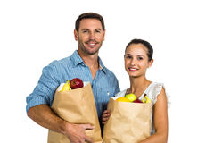 Couple holding grocery bags Royalty Free Stock Images