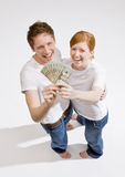 Couple holding group of twenty dollar bills Royalty Free Stock Photography