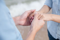 Couple holding hand by the beach Royalty Free Stock Photo