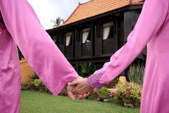 Couple holding a hand Stock Photos