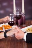 Couple Holding Hand At Restaurant Stock Photos