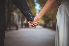 Couple holding hand together in park Stock Image