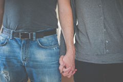Couple holding handgs. Perspective of a couple holding hands Stock Image