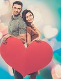 Couple holding handmade heart stock images