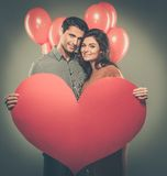 Couple holding handmade paper heart Royalty Free Stock Photo