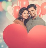 Couple holding handmade paper heart Stock Photo