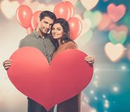 Couple holding handmade paper heart Stock Photography