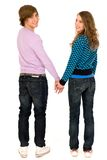 Couple holding hands. Happy young couple holding hands and smiling Stock Photography