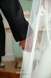 Couple holding hands stock images