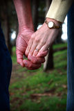 Couple holding hands. Soon to be married couple holding hands Stock Photos