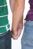 Couple Holding Hands. Against white background Royalty Free Stock Photos