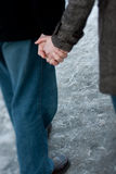 Couple holding hands. An engage couple holding hands while walking at a park Stock Photos