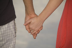 Couple holding hands. A couple walking hand in hand along the beach Royalty Free Stock Photo