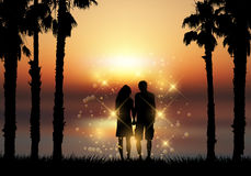 Couple holding hands against a sunset background Stock Photography