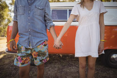 Couple holding hands against van Royalty Free Stock Photography
