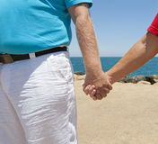 Couple holding hands on beach Royalty Free Stock Photography