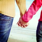 Couple holding hands in beach Stock Photos