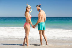 Couple holding hands on beach Royalty Free Stock Images