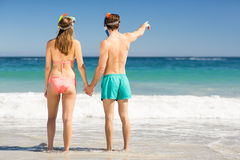Couple holding hands on beach Stock Image