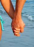 Couple holding hands on a beach Royalty Free Stock Images
