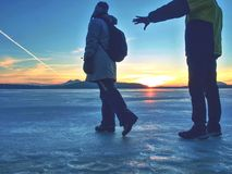 Couple holding by hands. Beautiful people in puffy jackets stock image