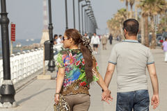 A couple holding hands, Beirut. A couple holding hands walking along the seafront in Beirut, Lebanon Stock Image