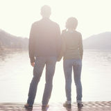 Couple holding hands on berth Stock Image