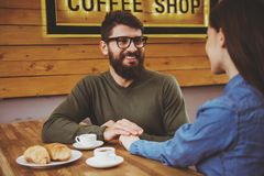 Couple Holding Hands in Cafe. royalty free stock images