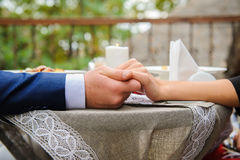 Couple holding hands in cafe Royalty Free Stock Image