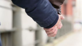 Couple holding hands in city stock video footage
