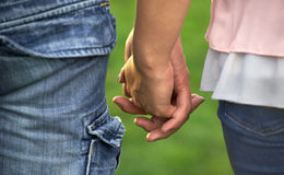 A couple holding hands. Close-up of hands Stock Photo