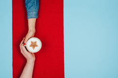 Couple holding hands with coffee on colorful table, top view Stock Photo