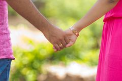 Couple holding hands. Depicting love and happiness in relationship Royalty Free Stock Photo