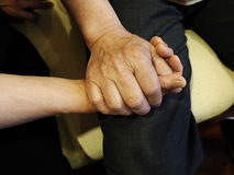 Couple holding hands with each other Stock Images