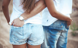 Couple holding hands in each other pocket Stock Image