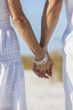 Couple Holding Hands on An Empty Beach Royalty Free Stock Image