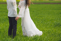 Couple Holding Hands in Field Stock Image