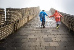 Couple holding hands at The Great Wall Badaling section with clouds and mist, Beijing, China stock photos
