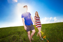 Couple holding hands on green field Stock Photography