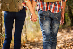 Couple holding hands hiking Stock Photos