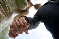 Couple holding hands and kissing Royalty Free Stock Image