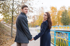 Couple Holding Hands and Looking Back at Camera Stock Image