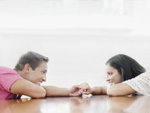Couple Holding Hands And Looking At Each Other Stock Images