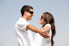 Couple holding hands and looking eachother Royalty Free Stock Photography