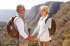 Couple holding hands. Loving middle aged couple holding hands in mountain royalty free stock images