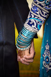 Couple holding hands. Loving couple holding hands showing bangles Royalty Free Stock Photography